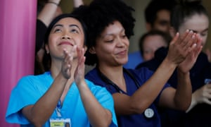 NHS workers applaud at the Aintree University Hospital during the last day of the Clap for our Carers campaign.