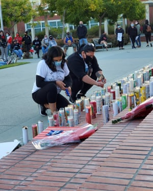People light candles at a vigil for Vanessa Guillén in Richmond, California.