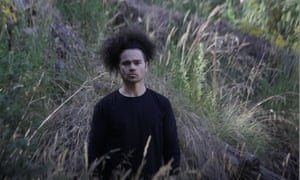 It's time for a sacred voice to shine, says Neil Morris for IndigenousX, seen here in this screenshot of the music video for 'Australia does not exist'.
