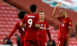 Liverpool's Fabinho (right) celebrates scoring his side's third goal of the game with teammates during the Premier League match at Anfield, Liverpool.