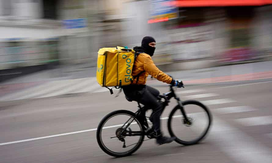 A Glovo food delivery delivery man in Madrid during the first wave of the pandemic