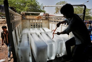 Ice bars loaded on to a truck from a factory on the outskirts of Ahmedabad