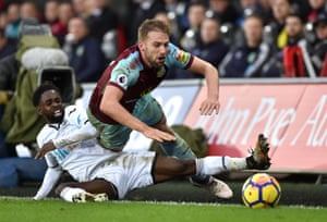 Burnley's Charlie Taylor receives a challenge from Swansea City's Nathan Dyer as The Swans win 1-0 at the Liberty stadium.
