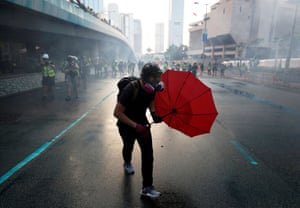 An anti-government protester protects himself with an umbrella during a demonstration in Hong Kong in September.