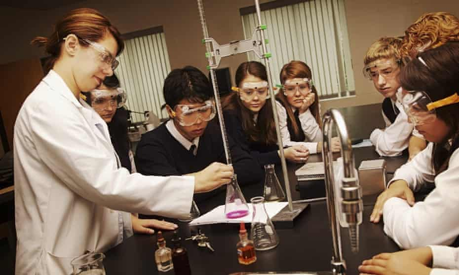 Teenage pupils in a chemistry class
