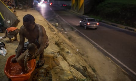 Man washes child in Brazil