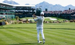 Rickie Fowler tees off in front of a huge crowd around the 16th hole at the Phoenix Open in Scottsdale, Arizona.