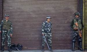 Indian paramilitary troopers stand guard at a closed commercial hub in Srinagar, the largest city in Jammu and Kashmir.