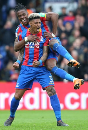 Patrick van Aanholt celebrates scoring their fourth goal with a little help from first goal scorer Wilfried Zaha.