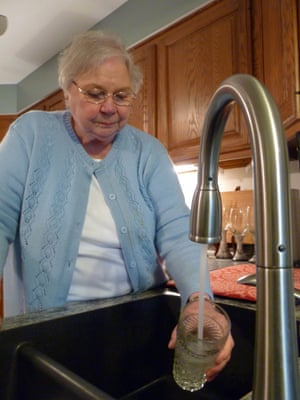 Councillor Julie Adams fills a glass of water from her kitchen tap.