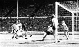 West Ham United's Trevor Brooking (third l) heads the winning goal past Arsenal goalkeeper Pat Jennings (third r)