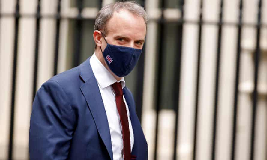 Britain's foreign secretary, Dominic Raab, walks outside Downing Street in London