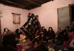 A Bedouin woman wearing traditional clothes dances for tourists in Umm Yasser's home