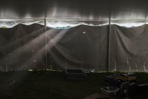 Sunlight leaks through a tent wall.