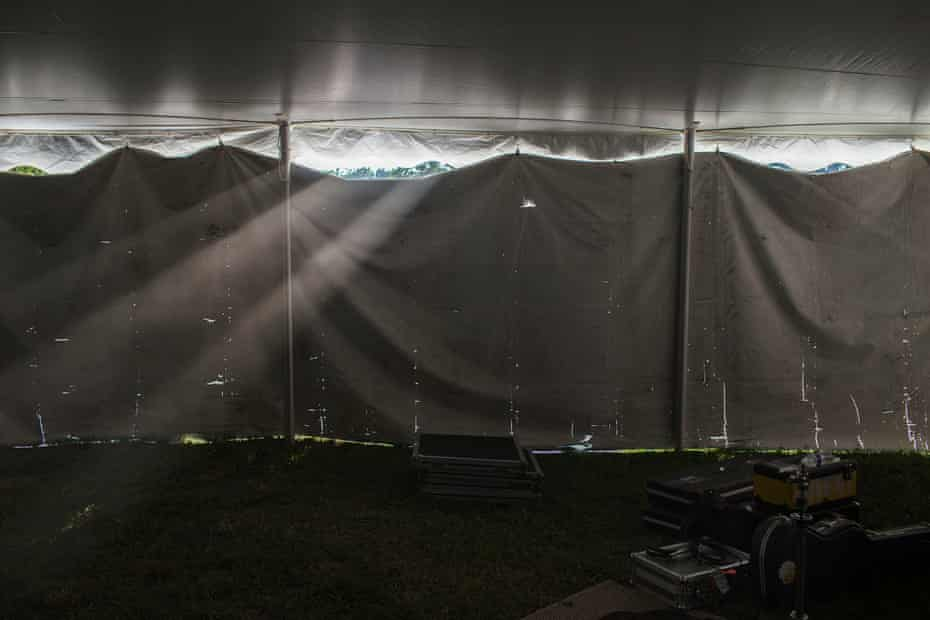 Sunlight leaks through a tent wall.