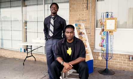 Terrell Griffin and Xavier Coleman (left) in front of the CDs and candy they sell next to a Family Dollar store in Baton Rouge, La.