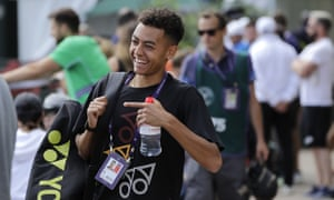 Jubb flashes a winning smile as he arrives for a training session at Wimbledon in June 2019.