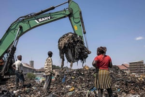 Nairobi, Kenya: an excavator moves garbage at a dumping site near Dandora informal settlement. The environment and land court ordered the closing of the site within six months