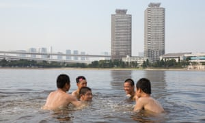 People cool off in Odaiba kaihin park during a deadly heatwave