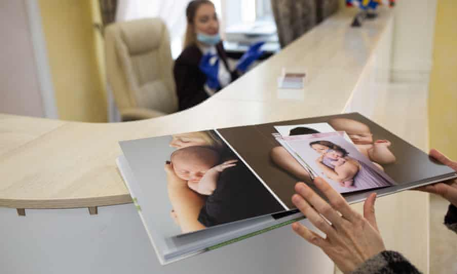 A BioTexCom promotional album showing clients and their new babies