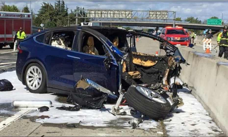 Emergency personnel work a the scene where a Tesla electric SUV crashed into a barrier on US Highway 101 in Mountain View, California, in 2018.
