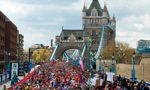 Runners pour over Tower Bridge in the London Marathon but mass participation may not be possible this year