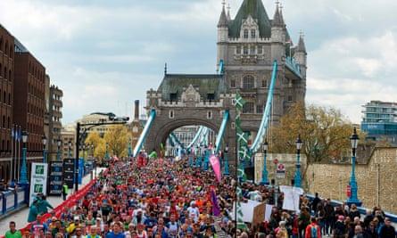 Runners cross Tower Bridge in the 2016 London Marathon.