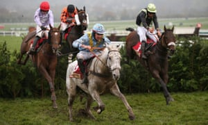 Diesel D'Allier, centre, and Urgent De Gregaine, right, jump the final fence in November's Cross Country Chase at Cheltenham.