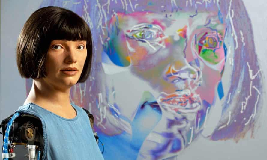 Ai-Da the robot next to one of its self-portraits