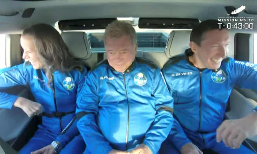 William Shatner and other passengers are driven to the launch pad of Blue Origin's New Shepard rocket Wednesday.