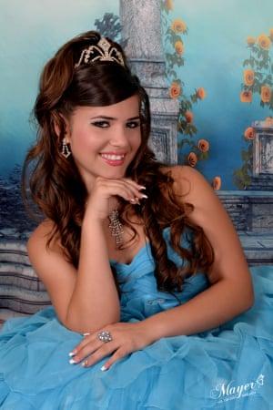 Yuliett Abreu Rodriguez, 15, poses for a portrait in a traditional dress at Estudio Mayer