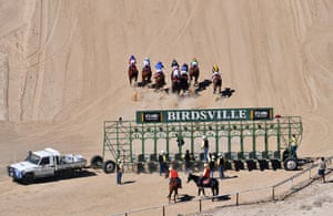 The horses take off from the stalls at the start of race two