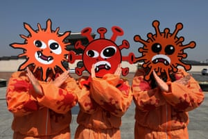 Seoul, South KoreaEnvironmental activists wearing masks symbolising the coronavirus attend a prevention campaign as South Koreans take measures to protect themselves against the spread of then illness.