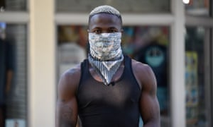 A man covers up with a bandana in Miami Beach, Florida