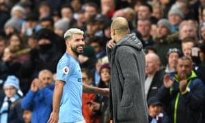 Sergio Agüero of Manchester City shares a word with Pep Guardiola