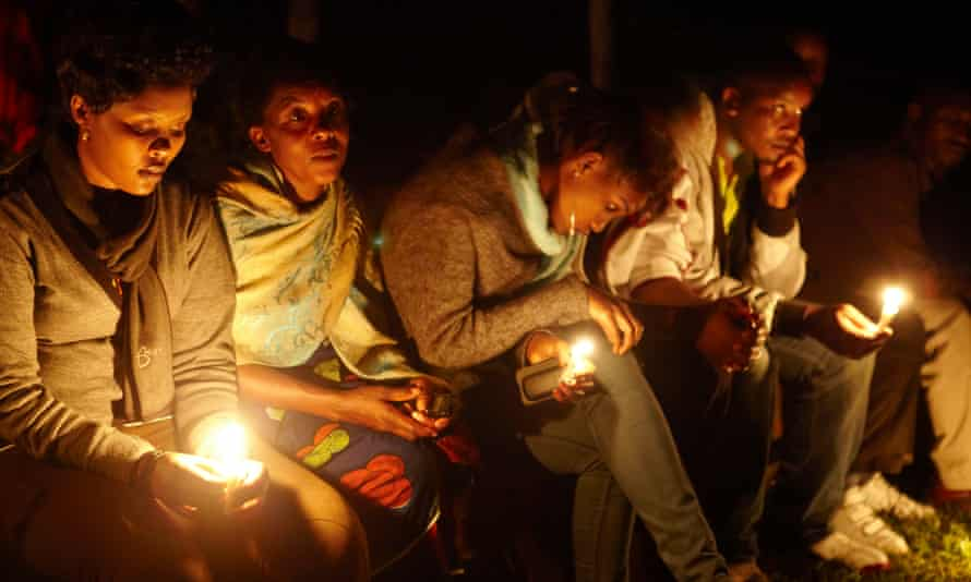 A candlelit vigil on a site where 11,000 people were killed in the Rwandan genocide