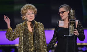 Debbie Reynolds receives a lifetime achievement award from her daughter, Carrie Fisher, at the Screen Actors Guild awards, Los Angeles, 2015.