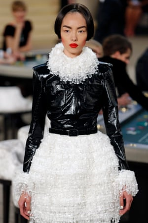 A model in a lace and PVC dress.