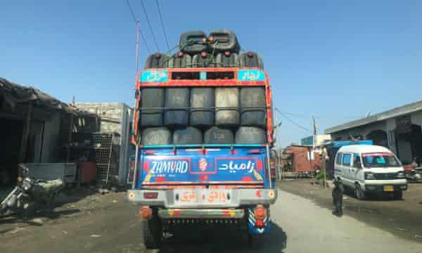 One of the Zamyad pickup trucks loaded with empty barrels.