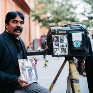 On one of Jaipur's main streets, near the Hawa Mahal (Palace of the Winds), Teekam Chand is setting up his World War I era box camera to take his next portrait.