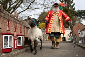 Wimborne, UK. Chris Brown, the town crier and mayor's serjant of Wimborne minster, in Dorset, exercises the tradition as an honorary freeman to drive sheep through Wimborne without charge, albeit through the model town, to herald the reopening on 12 April after the easing of lockdown restrictions