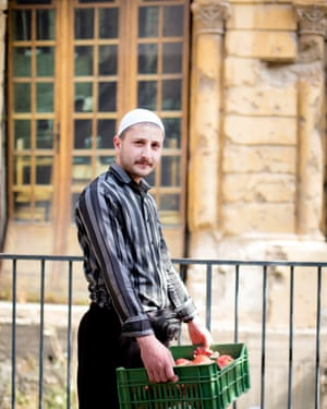 Naseem Abou Mansour, the son of a Druze sheikh, sells pomegranates at the Souk el Tayeb farmers' market in Beirut.