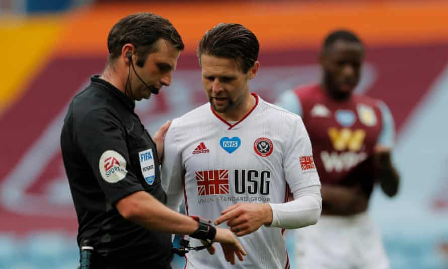 Sheffield United's Oliver Norwood confronts Michael Oliver at Villa Park but the referee received no goal alert from either his watch or earpiece, which are supposed to inform him if the ball has crossed the line.