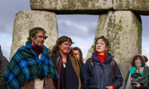 People with face paint at Stonehenge