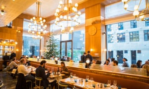 Bright lights and shiny surfaces in Aquavit restaurant