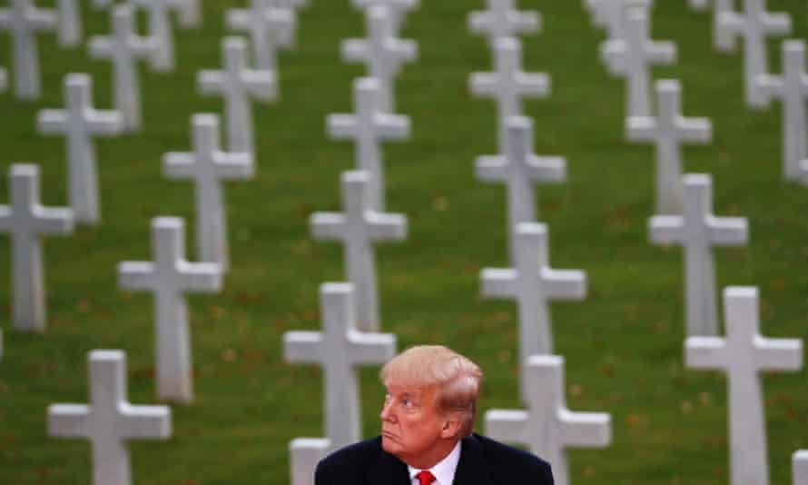 Donald Trump in front of graves
