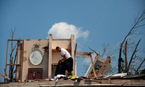 A man in his tornado-damaged home in Trotwood, Ohio, last month.