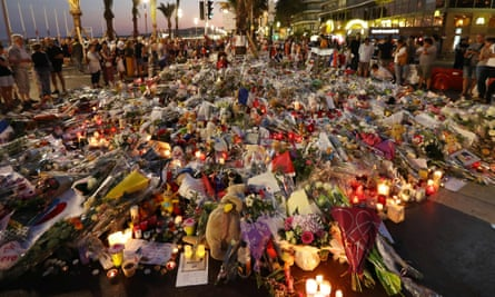 Fowers, candles and messages laid at a makeshift memorial in Nice