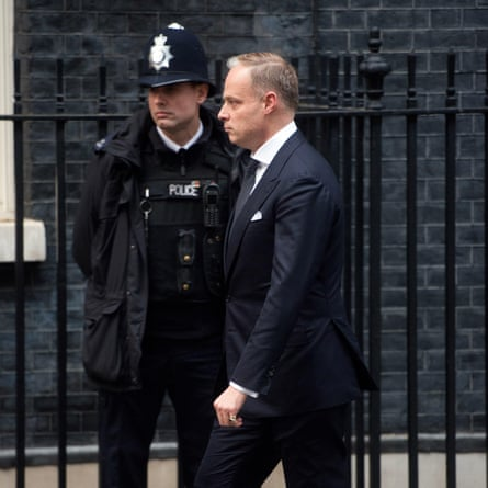 The Hungarian ambassador in the UK, Kristóf Szalay-Bobrovniczky, walking past a police officer in Downing Street.