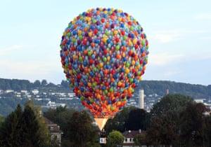 A hot air balloon rises during the International German Cup gathering in Pforzheim